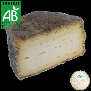 Tome bio de fromage de lait cru de vache affinée aux artisous en Haute-Loire